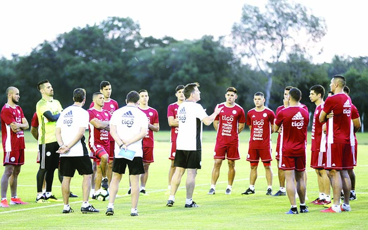 Paraguay's National Soccer team coach Eduardo Berizzo (center) talks to his players during a training session at Ypane, Paraguay on Monday. Paraguay started its training program ahead of the Copa America championship that will be played in Brazil.