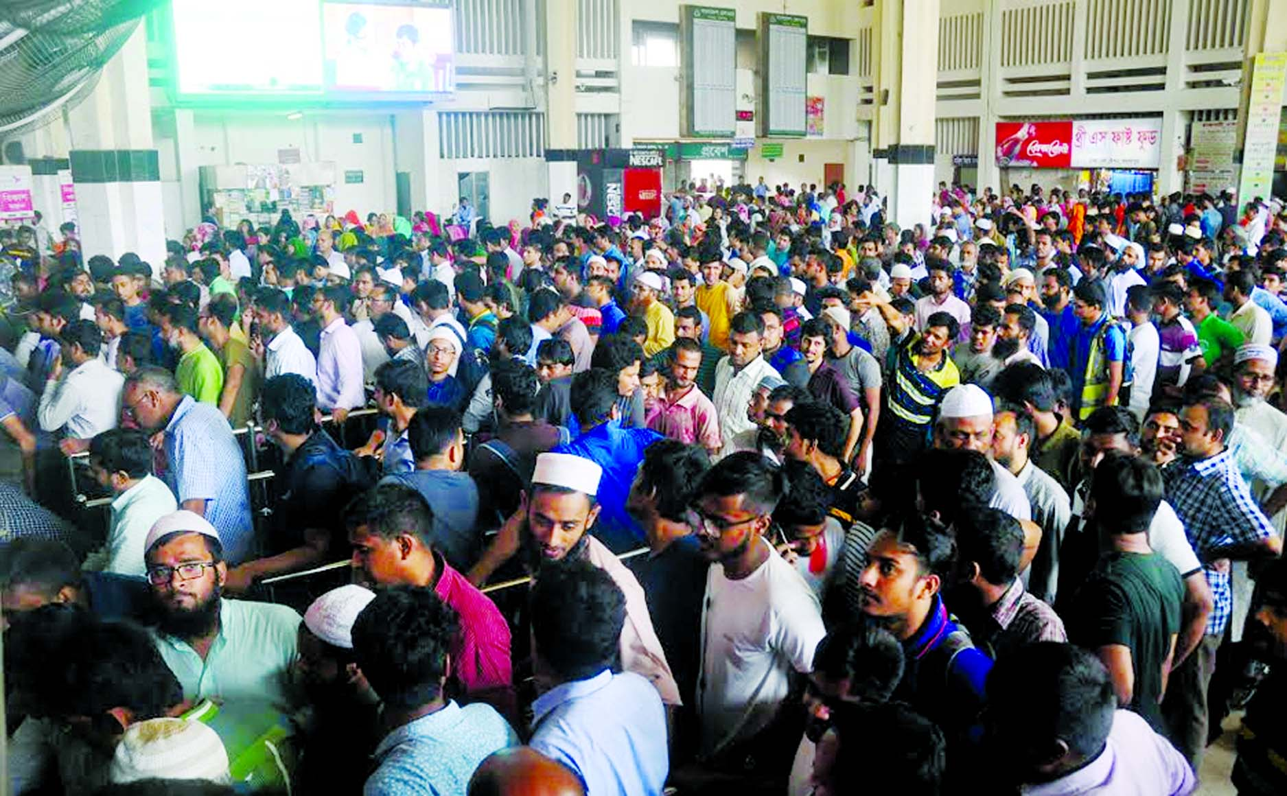 we must Go home : Thousands queue up at Kamalapur Railway Station for advance tickets on Tuesday.
