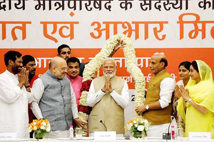 Modi's party promises to boost India's economy; Congress calls exit polls fake