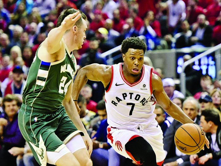 Toronto Raptors guard Kyle Lowry (7) drives for the basket as Milwaukee Bucks guard Pat Connaughton (24) defends during the second half of Game 4 of the NBA basketball playoffs Eastern Conference finals in Toronto on Tuesday.