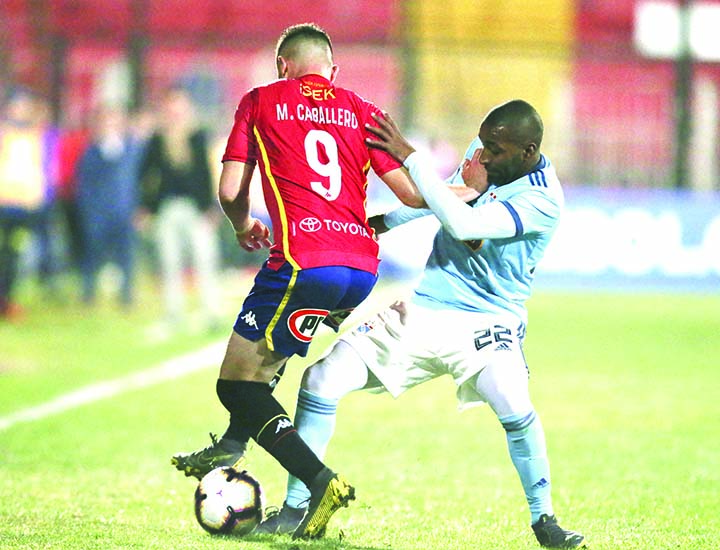 Mauro Caballero of Chile's Union Española (left) fights for the ball with Jair Cespedes of Peru's Sporting Cristal, during a Copa Sudamericana soccer match in Santiago, Chile on Tuesday.