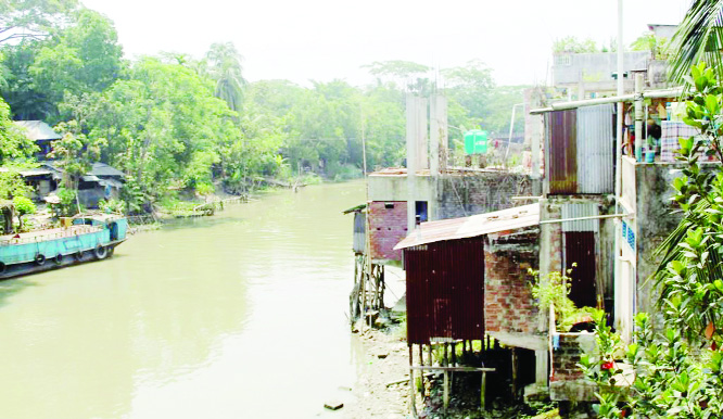 BARISHAL: Influentials building illegal  constructions  by grabbing Shandha River  at  Uzipur Upazila . This snap was taken yesterday.