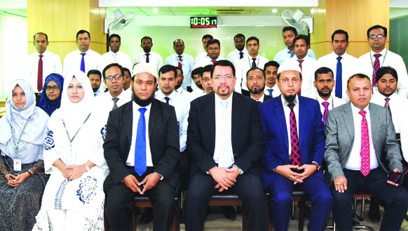 Farman R Chowdhury, Managing Director of Al-Arafah Islami Bank Ltd, poses with the participants of a Two-day long training workshop on 'Financial Statement Analysis' at its Training Institute on Monday. Principal of the Institute and Executive Vice President Md. Abdur Rahim Duary, Vice President Touhid Siddique and Assistant Vice President Mohammad Mujibur Rahman were also present.