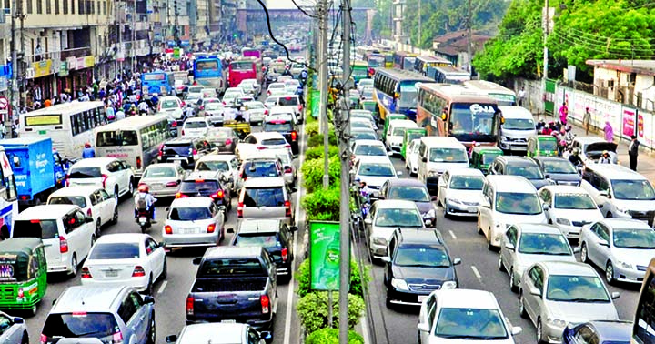 Thousands of vehicles remained stuck at a huge traffic gridlock in different city roads, causing untold sufferings to commuters. This photo was taken from Kakoli-Banani area on Thursday.