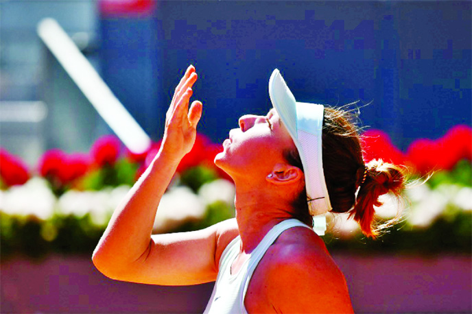 'Happy' Halep feeling less pressure at French Open