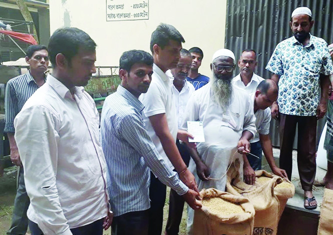 MIRZAPUR(Tangail): Officials of Food Department   procuring   paddy from farmers at Mirzapur Upazila on Thursday.