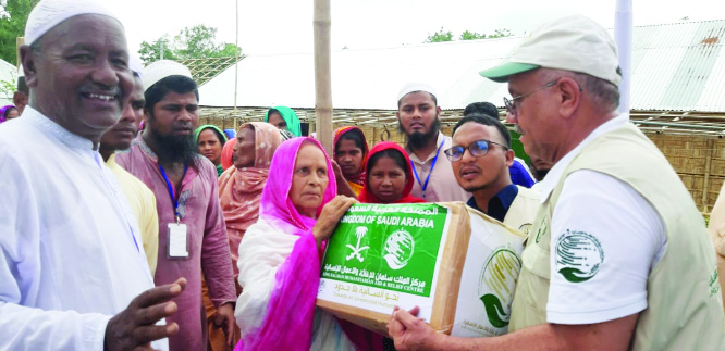 SYEDPUR ( Nilphamari) : King Salman Humanatrian Aid and Relief Centre distributing  Iftar items among underprivileged people  through  International Organization for Relief, Welfare and Development (IORWD) at  Jamiria Madrasa  ground at Hazarihat Union under Syedpur Upazila  in Nilphamari  yesterday.