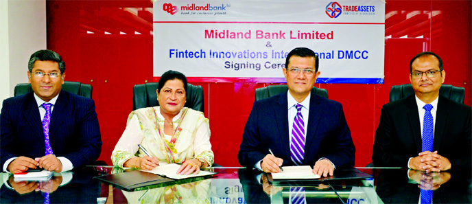 Md. Ahsan-uz-Zaman, Managing Director of Midland Bank and Azizunnessa Huq, Executive Director of Fintech Innovations International DMCC, a UAE based organization, sign an agreement at the Bank's head office in the city on Thursday. Under the deal, the Bank will use TRADEASSETS platform- an online portal that will support MDB's digitization goals by shifting trade finance origination and distribution into a real-time, 24/7 automated environment.