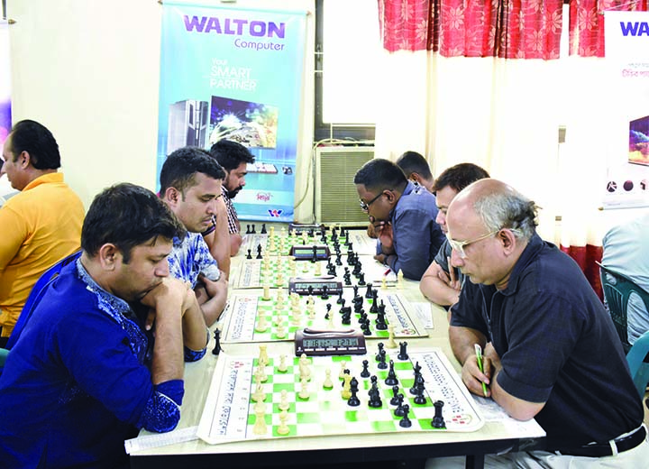 A scene from the fifth round matches of the Walton International Rating Chess Competition at Bangladesh Chess Federation hall-room on Saturday.