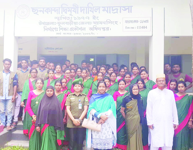 FULBARI(Mymensingh):  Ansar and VDP members posed for a photo session   after a training course at Falbari Upazila  recently.