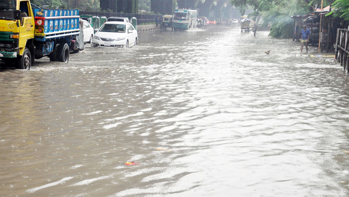 Low- lying areas at Port City  submerged  due to heavy rainfall . This picture was taken from   Muradpur yesterday.