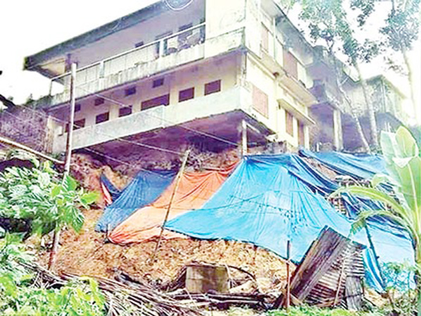The damaged  structures of three years back at Kaderia Market building in Kallyanpur area in Rangamati town  to be repaired yet. Local residents fear that major accidents might occur with the collapse of the shabby buildings at any time in the rainy season. The photo was taken on Thursday.