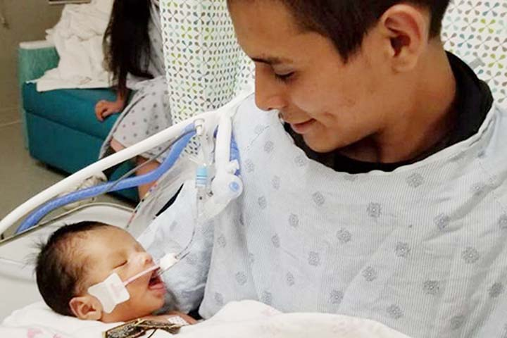 US infant boy cut out of mother's womb dies at hospital