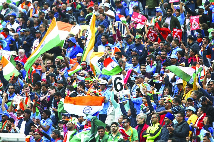 Indian fans celebrate a six during the ICC  World Cup Cricket match between India and Pakistan at Old Trafford in Manchester, England on Sunday.