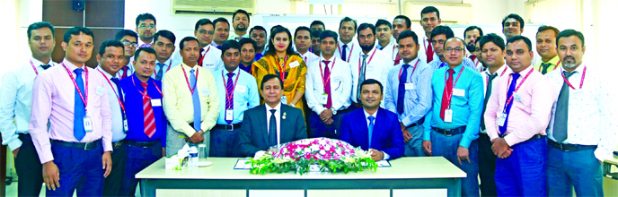 Md. Tariqul Azam, Additional Managing Director of Standard Bank Limited poses with the participants of a three-day long training on