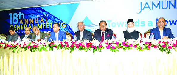 Engr Md Atiqur Rahman, Chairman of the Board of Directors of Jamuna Bank Ltd, presiding over the Bank's 18th Annual General Meeting at the Police Convention Center in the city on Sunday. Jamuna Bank Foundation Chairman Al-Haj Nur Mohammed, Managing Director Shafiqul Alam and Company Secretary M A Rouf, among others, were present.