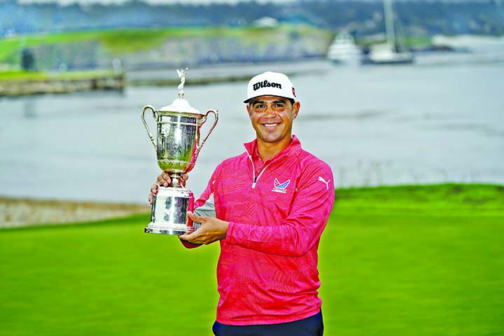 Gary Woodland posses with the trophy after winning the U.S. Open Championship golf tournament in Pebble Beach, Calif on Sunday.