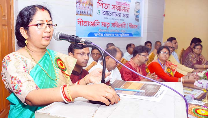 Social worker Anita Chowdhury speaking at a reception programme of Gitanjoli marking the World Father's Day on Sunday.