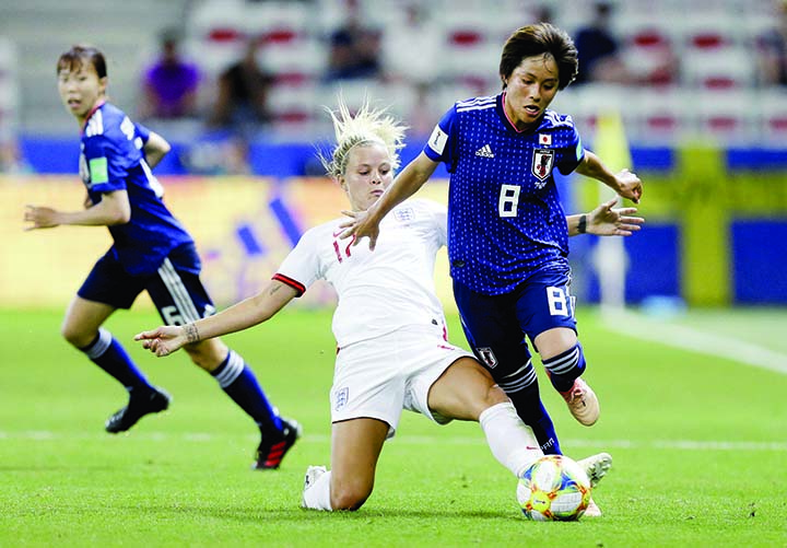 England's Rachel Daly (left) and Japan's Mana Iwabuchi (right) challenge for the ball during the Women's World Cup Group D soccer match between Japan and England at the Stade de Nice in Nice, France on Wednesday.