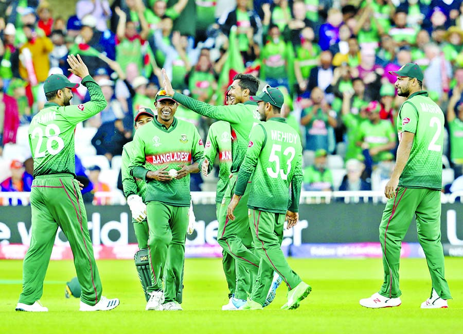 Bangladesh's Soumya Sarkar (third right) celebrates with teammates the dismissal of Australia's captain Aaron Finch during the ICC World Cup Cricket match between Australia and Bangladesh at Trent Bridge in Nottingham on Thursday. Soumya grabbed three wickets at the cost of 58 runs. Australia piled up a massive 381 for the loss of five wickets in the allotted 50 overs.
