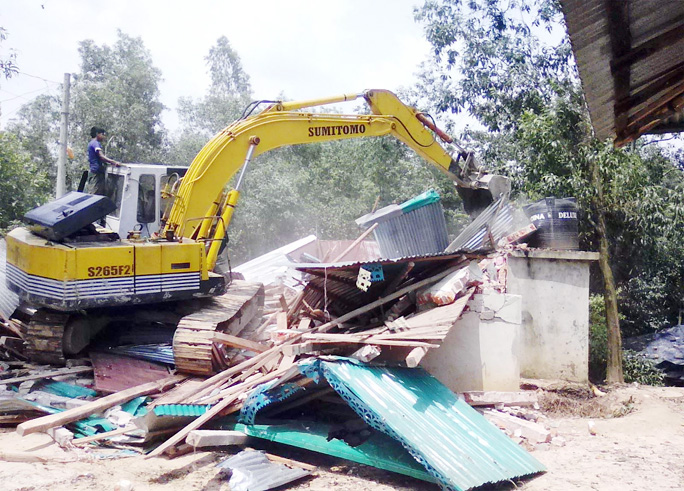Mobile Court evicting illegal constructions from Islamnagar in Chakoria Upazila on Tuesday.