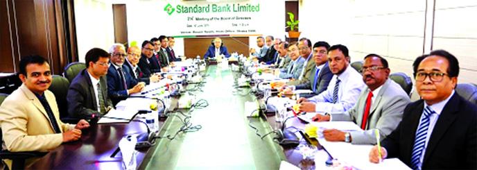 Kazi Akram Uddin Ahmed, Chairman of the Board of Directors of Standard Bank Ltd, presiding over the Bank's 314th Board Meeting at its head office in the city on Wednesday. Vice-Chairman Al-Haj Mohammed Shamsul Alam, Directors Kamal Mostafa Chowdhury, Ashok Kumar Saha, Ferozur Rahman, S A M Hossain, Mohammed Abdul Aziz, Gulzar Ahmed, Md Zahedul Hoque, Ferdous Ali Khan, Al-Haj Mohd Yousuf Chowdhury, Kazi Sanaul Hoq, S S Nizamuddin Ahmed, Najmul Huq Chaudhury and Md Nazmus Salehin and Managing Director Mamun-Ur-Rashid, among others, were present.