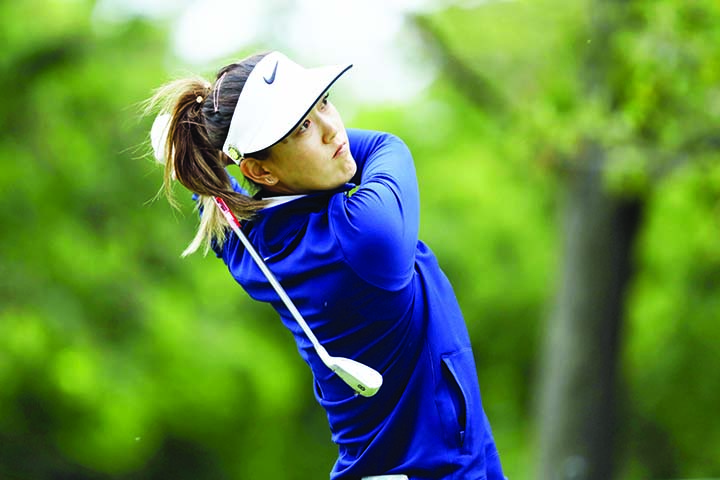 Michelle Wie hits off the 17th tee during the second round of the KPMG Women's PGA Championship golf tournament on Friday.