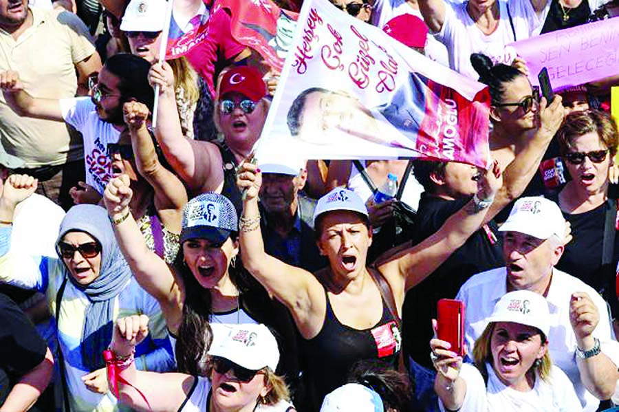 Supporters of Ekrem Imamoglu, candidate of the secular opposition Republican People's Party (CHP) react during his last election rally in Istanbul.