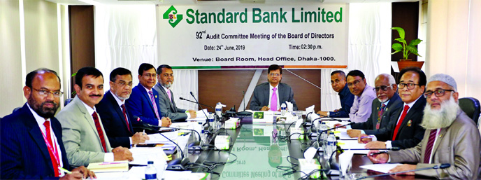 Md Nazmus Salehin, Chairman of the Audit Committee of the Board of Directors of Standard Bank Ltd, presiding over the Bank's 92nd board meeting at its board room in the city on Monday. Members of the committee Al-Haj Mohammed Shamsul Alam, Kazi Sanaul Hoq, Najmul Huq Chaudhury, Ferdous Ali Khan, Managing Director Mamun-Ur-Rashid, Additional Managing Director Md Tariqul Azam and Deputy Managing Director Md Motaleb Hossain, among others, were present.
