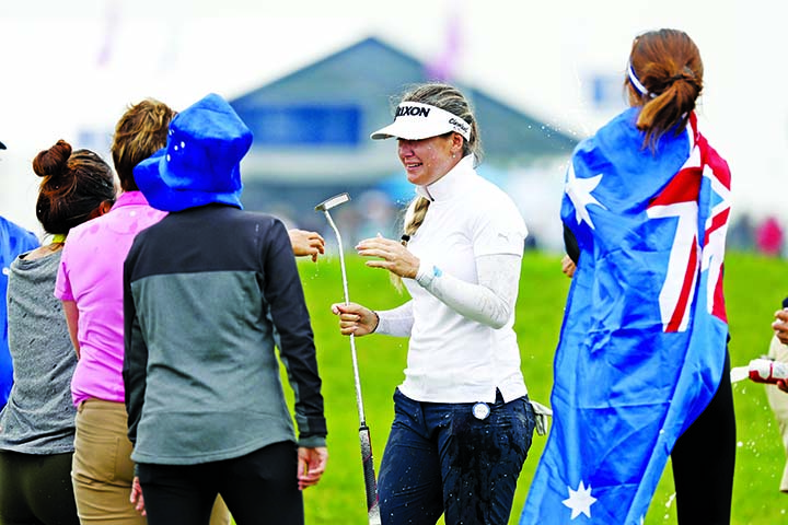 Hannah Green (center) of Australia celebrates with fans after winning the KPMG Women