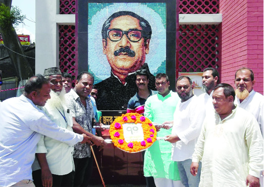 MIRZAPUR (Tangail): Leaders of Mirzapur Upazila Awami League placing wreaths at the  portrait of Bangabandhu Sheikh Mujibur Rahman marking the 70th founding anniversary of Bangladesh Awami League on Sunday.