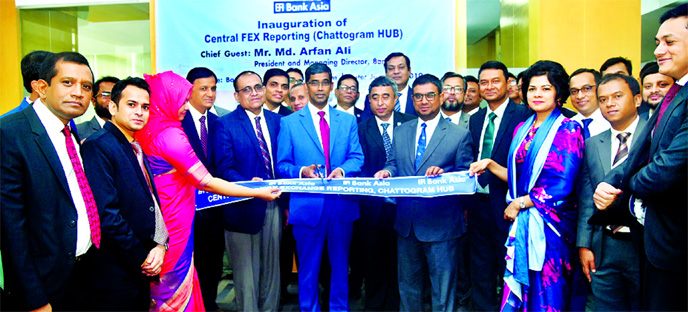 Md Arfan Ali, Managing Director of Bank Asia Ltd, inaugurating a Central Foreign Exchange Reporting Hub to ensure specialized customer services and automated reporting of foreign trade related transactions at its Zonal Office at Agrabad in Chattagram recently. Md Zia Arfin, Head of International Division and AKM Shaiful Islam Chowdhury, among others, were present.