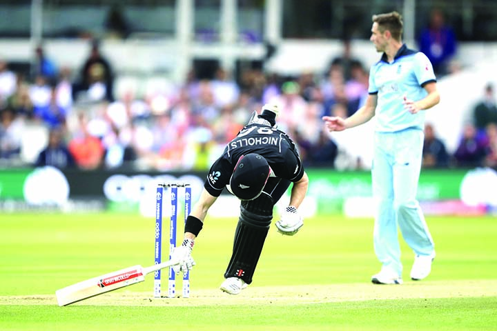 New Zealand's Henry Nicholls gets in safe to avoid a run out during the ICC World Cup Cricket final match between England and New Zealand at the Lord's cricket ground in London on Sunday.