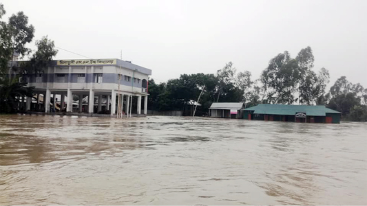 JAMALPUR:  Chilnaduli  S N High School at Islampur Upazila has been  marooned  due to flood. This snap was taken yesterday.