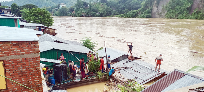 Low areas at Bandarban suffering a lot as most of the areas are flooded . This snap was taken  from  Marma Bazar on Sunday.