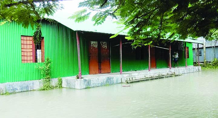 JAMALPUR:  Kolkihara Community School at Bakshiganj Upazila has been  water-logged as flood situation further deteriorates in Jamalpur. This snap was taken yesterday.