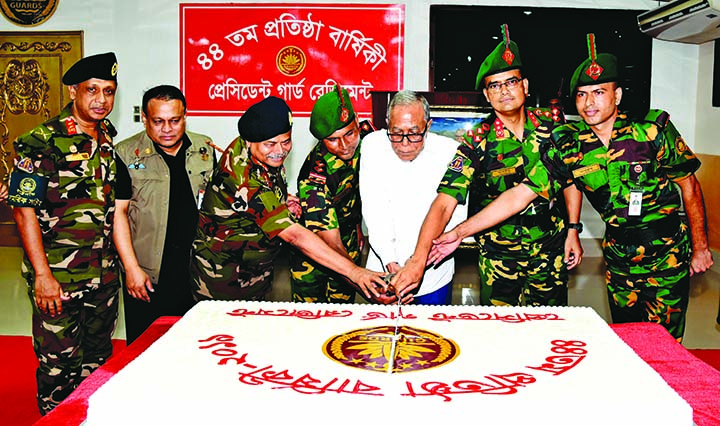 President Abdul Hamid along with high officials of President Guard Regiment (PGR) cutting cake marking the 44th founding anniversary of PGR at its Headquarters in Dhaka Cantonment on Tuesday.