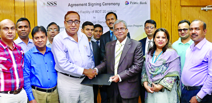 Md Touhidul Alam Khan, Deputy Managing Director of Prime Bank Limited and Md Abdul Hamid Bhuiyan, Executive Director of Society for Social Service (SSS), exchanging an agreement signing document at the bank's head office in the city recently for lending to the 10 taka account holders and group members under Financial Inclusion Programme of the bank.