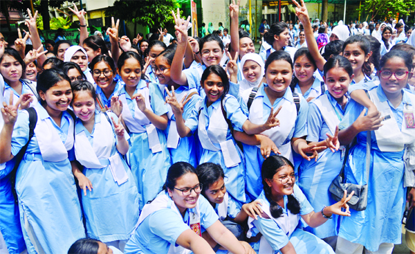 Teachers and students of the city's Viqarunnisa Noon School and College rejoicing on  the brilliant results of HSC examination. The snap was taken from the premises of the institution on Wednesday.