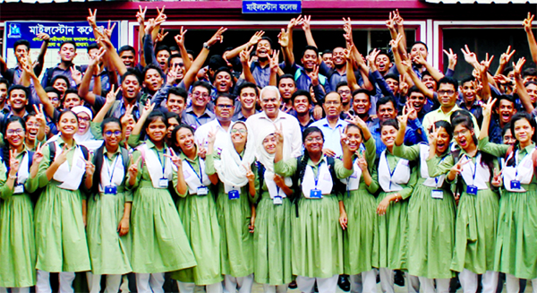 Students of the city's Milestone College showing victory (V) sign on their good results in the HSC examination on the premises of their institution on Wednesday.