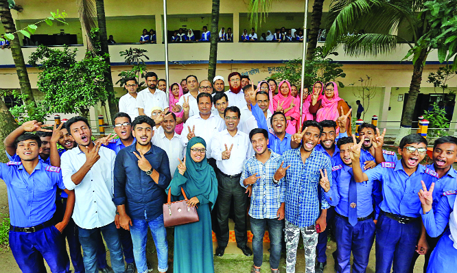 BOGURA: Jubilant students of Police Lines School and College posed for a photo session with Principal  of the College after their brilliant HSC result on Wednesday.