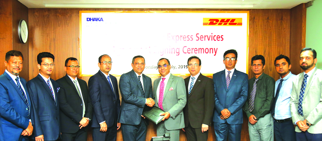 Syed Mahbubur Rahman, Managing Director of Dhaka Bank Ltd and Md Miarul Haque, Country Manager of DHL Worldwide Express (BD) Pvt. Ltd, exchanging a signing document for international correspondence and communication at the Bank's corporate office recently. Md. Shakir Amin Chowdhury, DMD, Md. Altamas Nirjhar, Head of General Services Division of the Bank and ASM Shakil, Commercial Director of DHL were also present.