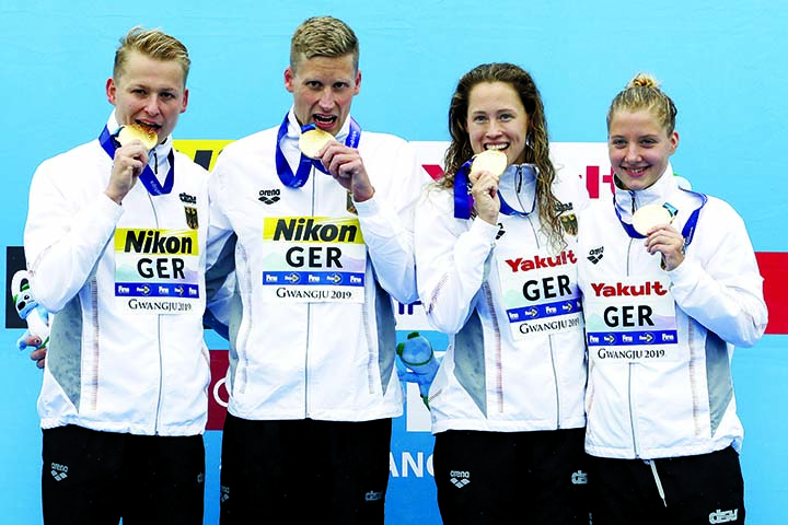 Members of the gold medal-winning team from Germany stand with their medals after the 5km mixed relay open water swim at the World Swimming Championships in Yeosu, South Korea on Thursday.