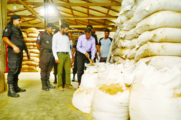 RAB-11 mobile team led by a magistrate raided a poultry and fish feed producing factory allegedly with tannery waste located at Siddhirganj in N'ganj and sealed the factory. Two persons were sent to jail. This photo was taken on Thursday.