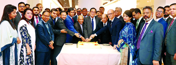 A Rouf Chowdhury, Chairman of the Bank Asia, celebrating an achievement of collection of Tk 1,000 crore deposits by cutting a cake at the bank's corporate office at Karwan Bazar in the city recently. Rumee A Hossain, Chairman of Board Executive Committee, Dilwar H Choudhury, Chairman of Board Audit Committee, Md Nazrul Huda, Chairman of Board Risk Management Committee, Enam Chowdhury, Ashraful Haq Chowdhruy, Directors of the Bank, Md Arfan Ali, Managing Director, Mohammad Borhanuddin and Sazzad Hossain, DMDs and Sarder Akhter Hamed, Head of Channel Banking Division, among others, were present.