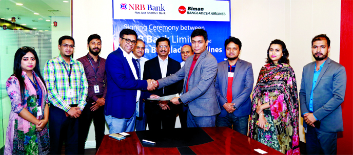 Mir Shafiqul Islam, Head of Cards NRB Bank Ltd and Mohammed Salahuddin, General Manager Marketing of Biman Bangladesh Airlines, exchanging an agreement signing document at the bank's corporate office recently. Under the deal, NRB Bank debit and credit cardholders will get 20 percent discount on business class for selective international sectors and 10 percent discount on all domestic sectors of Biman Bangladesh Airlines. Md Mehmood Husain, Managing Director of the bank and AFM Anisur Rahman, Officer in Charge of Biman Bangladesh Airlines, were also present.