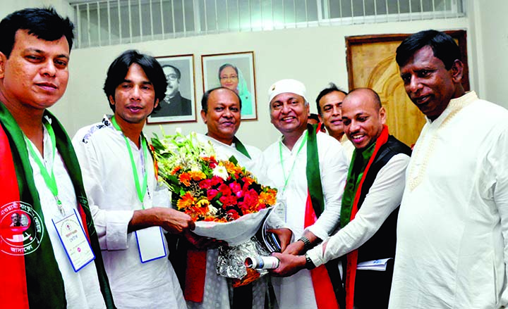 Newly elected President of Bangladesh Awami Sangskritik Forum Saidur Sajal being greeted with bouquets by different organisations at the triennial council of the forum at Mirpur Ashulia Beribandh Priyanka Shooting Zone in the city on Saturday.