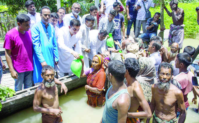 GAIBANDHA:  Mahmud Hasan Rimon, former President of Chhatra League distributing relief  goods among the flood- hit people at Jhumarbari Union  on Saturday.