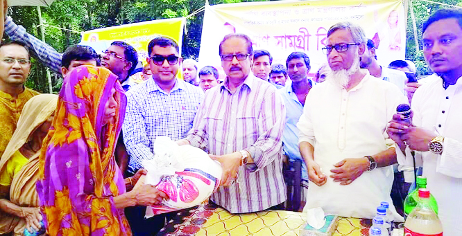 SYLHET:  Mahmud -us -Samad Chowdhury MP and Mustaquar Rahman Mofu, Chairman, Balaganj Upazila distributing relief materials among flood affected  people at Radhakona village on Saturday.