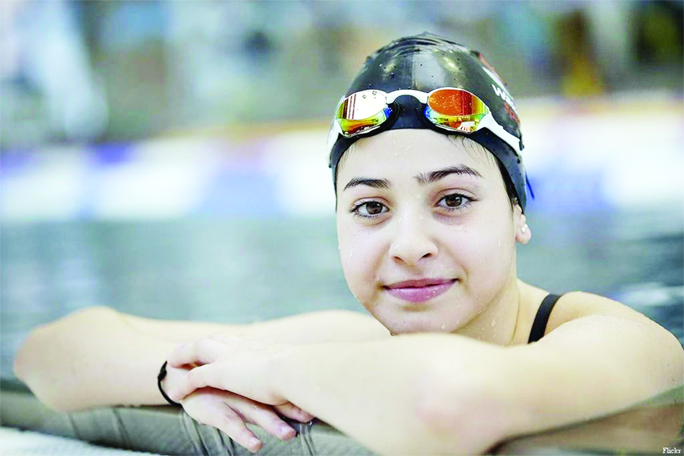Refugee swimmer Mardini rising fast after fleeing war